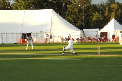 PlayingCricketOutsideMarquee